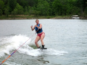 Yep, Kristen is drinking a beer while wakeboarding.  #badass